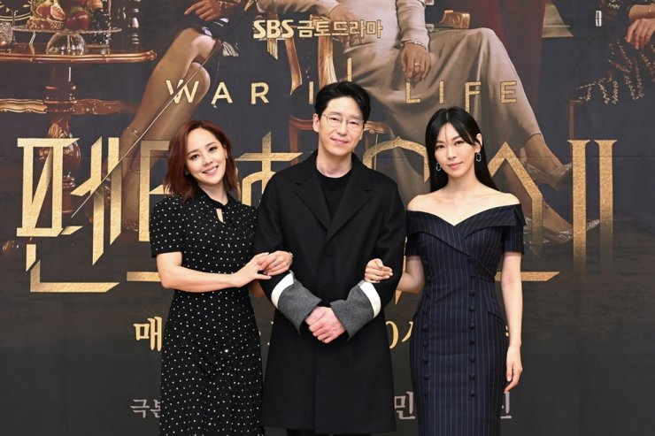 Actors Eugene, from left, Uhm Ki-joon and Kim So-yeon pose for pictures during the online media conference for 'Penthouse: War in Life.' Courtesy of SBS