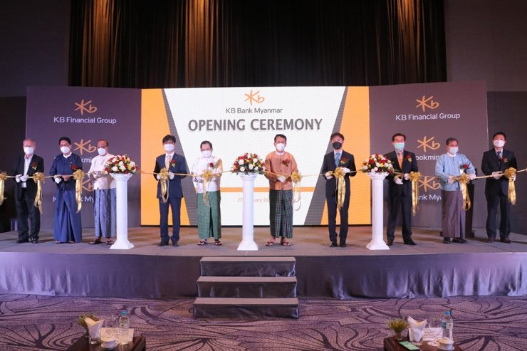 Officials from KB Kookmin Bank and Myanmar's government hold an opening ceremony for KB Bank Myanmar in Yangon on Jan. 27. Courtesy of KB Kookmin Bank