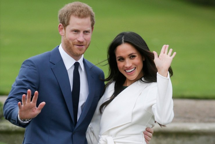 In this file photo taken on Nov. 27, 2017, Britain's Prince Harry and his fiancee Meghan Markle pose for a photograph in the Sunken Garden at Kensington Palace in west London following the announcement of their engagement. AFP