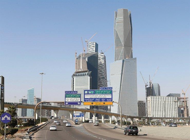 Cars drive past the King Abdullah Financial District in Riyadh, Saudi Arabia, in this 2018 file photo. Reuters-Yonhap