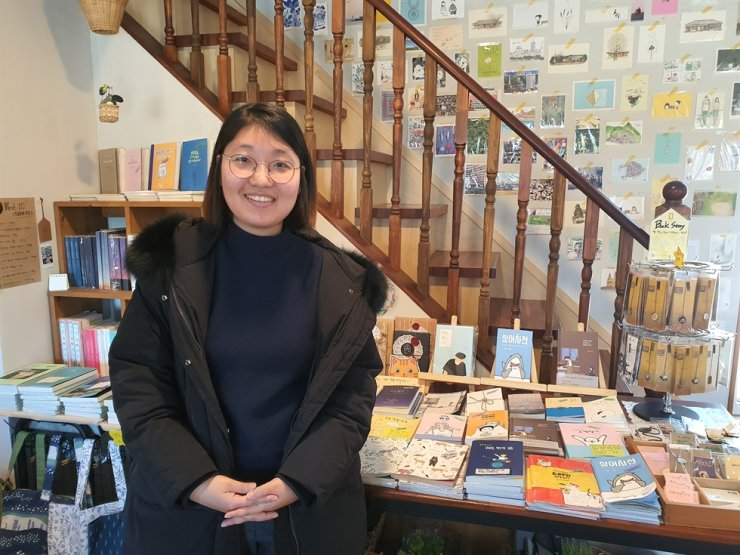 Lee Ji-su, author of an essay book titled 'Life out of Orbit,' poses for a photo at a bookstore in Seoul in this February 2020 photo.  Courtesy of Lee Ji-su