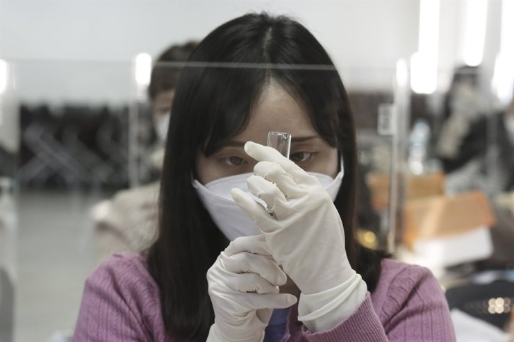 A medical worker attends a training session to learn how to give coronavirus vaccine shots at the Korean Nurses Association in Seoul, Wednesday, Feb. 17, 2021. AP