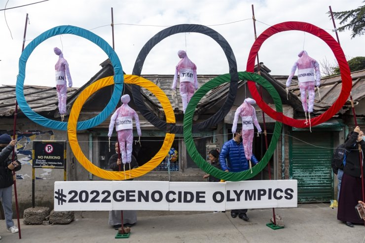 Exile Tibetans use the Olympic Rings as a prop as they hold a street protest against the holding of 2022 Winter Olympics in Beijing in Dharmsala, India, Wednesday, Feb. 3, 2021. AP