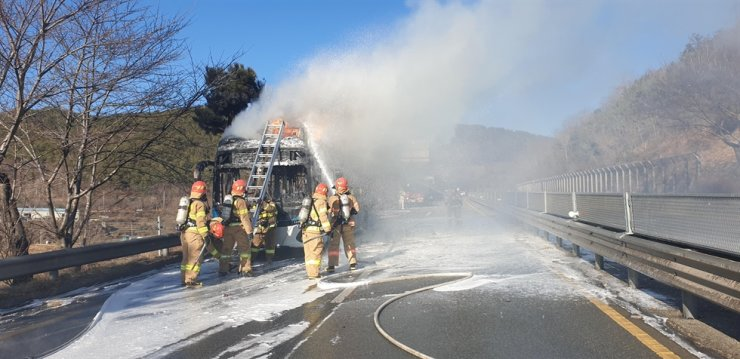Firefighters put out a fire on an electric bus near Changwon, South Gyeongsang Province, Feb. 15. The bus, a Hyundai Elec City, was equipped with LG Energy Solution's battery packs. Courtesy of Changwon Fire Department