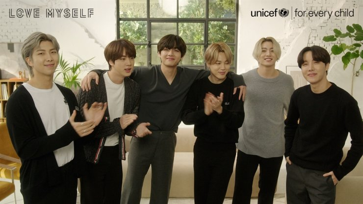 Members of BTS celebrate their agency Big Hit Entertainment re-signing a partnership with UNICEF Korea on Mar. 5. Courtesy of UNICEF Korea