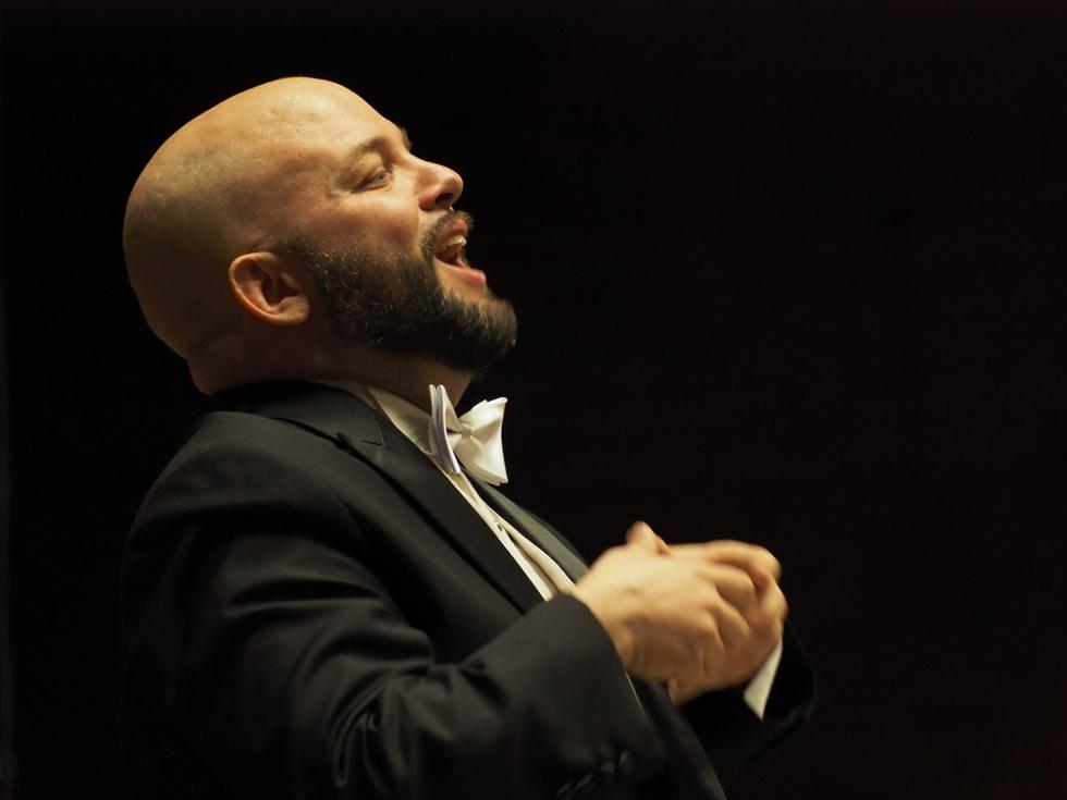 Ryan Goessl, center, conducts a Camarata Music event. / Courtesy of Camarata Music
