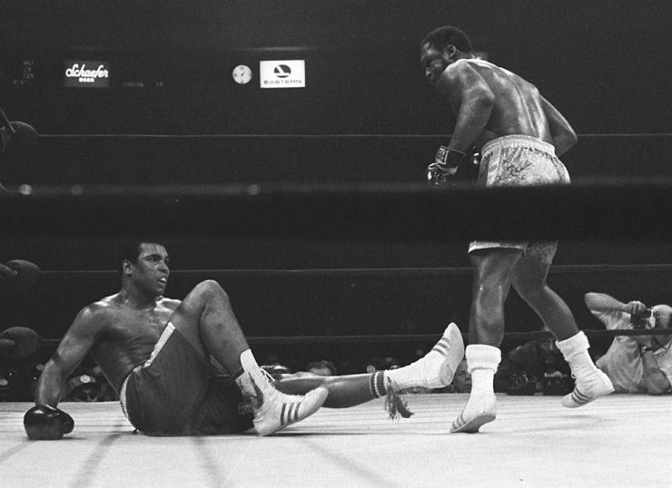 Joe Frazier stands over Muhammad Ali in the 15th round of their boxing match at Madison Square Garden in New York, in this March 8, 1971, file photo. AP