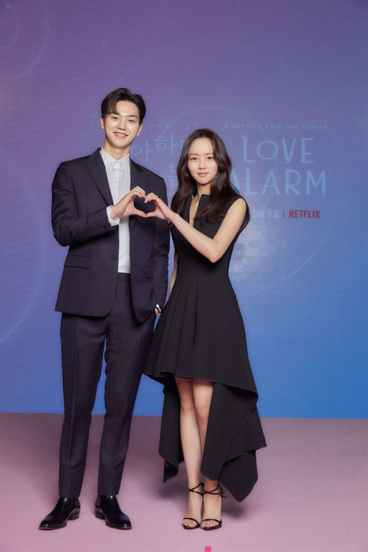 Song Kang, left, and Kim So-hyun pose during a press conference for the second season of 'Love Alarm' held in Seoul, Monday. Courtesy of Netflix
