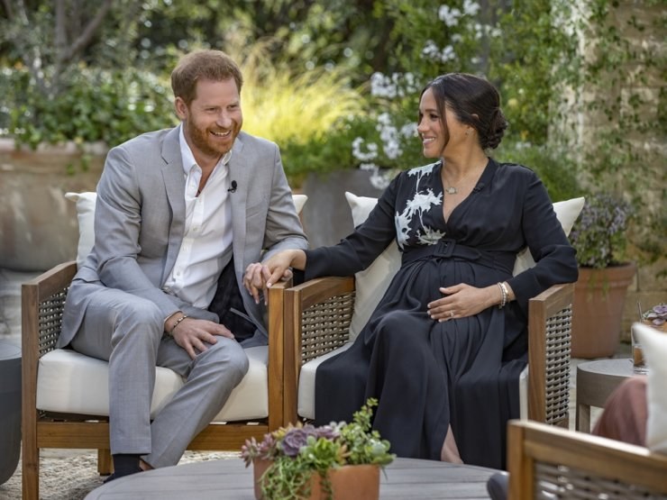 This image provided by Harpo Productions shows Prince Harry, left, and his wife Meghan speaking about expecting their second child during an interview with Oprah Winfrey. AP