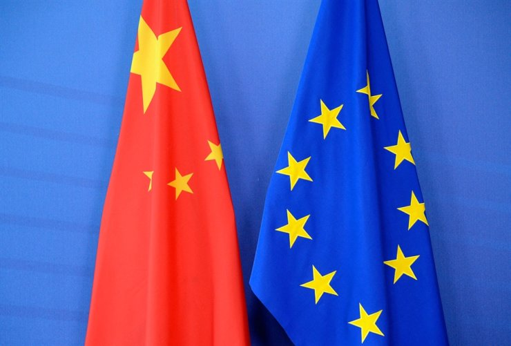 This file photo taken on June 29, 2015, shows China's flag beside the European Union flag during an EU-China Summit at the European Union Commission headquarters in Brussels. AFP