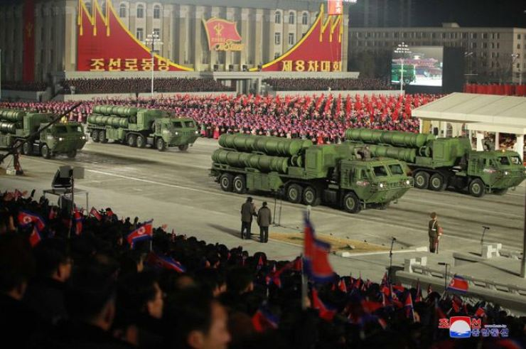 Vehicles carrying the North Korean military's weapons presumed to be cruise missiles are unveiled a military parade in Pyongyang on Jan.14 to mark the eighth congress of the country's ruling Workers' Party of Korea in this photo released by the country's state-run Korean Central News Agency the following day. Yonhap