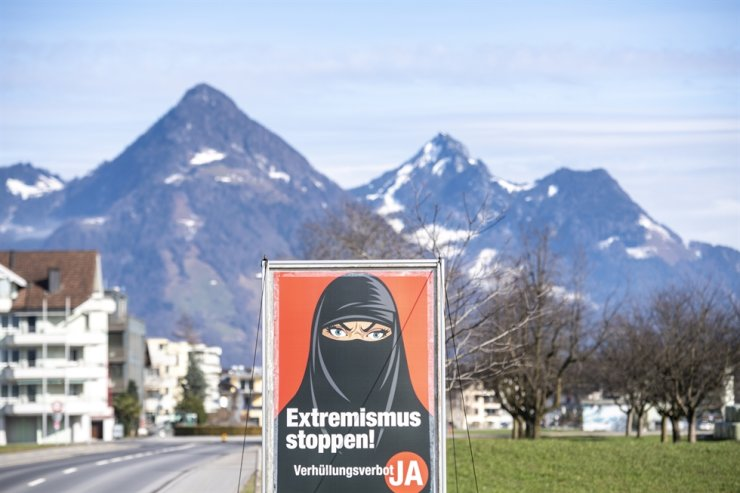 A poster of the initiative 'Yes to the burqa-ban' is seen in Oberdorf, in the canton of Nidwalden, Switzerland, Feb. 16, 2021. EPA