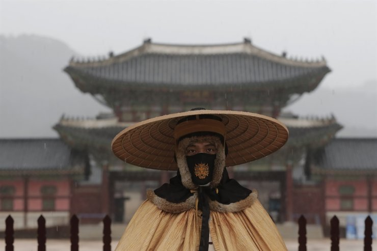 An Imperial guard wearing a face mask to help protect against the spread of the coronavirus stands outside the Gwanghwamun in Seoul, Monday, March 1, 2021. AP
