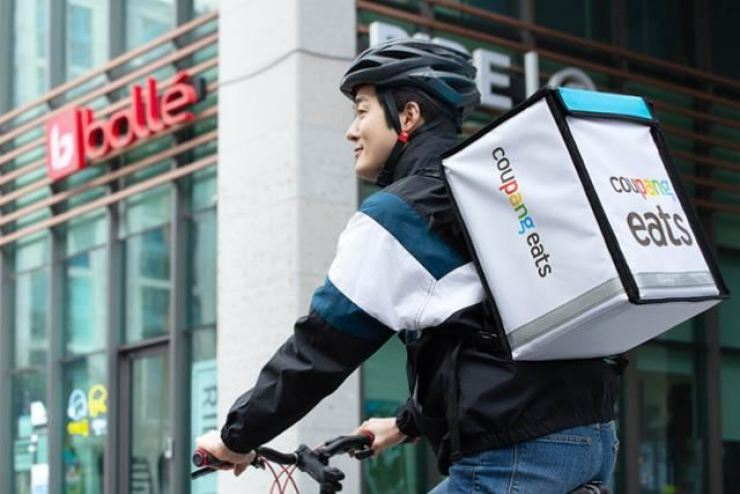 A Coupang Eats rider delivers food on a bicycle in Seoul, in this Jan. 31 handout photo. Courtesy of Coupang