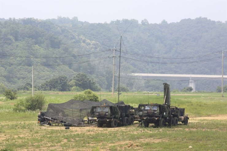 U.S. Army mobile equipment sits in a field in Yeoncheon, South Korea, near the border with North Korea, Wednesday, June 17, 2020. The State Department says the U.S. and South Korea have reached an agreement in principle on a new arrangement for sharing the cost of the American troop presence. AP
