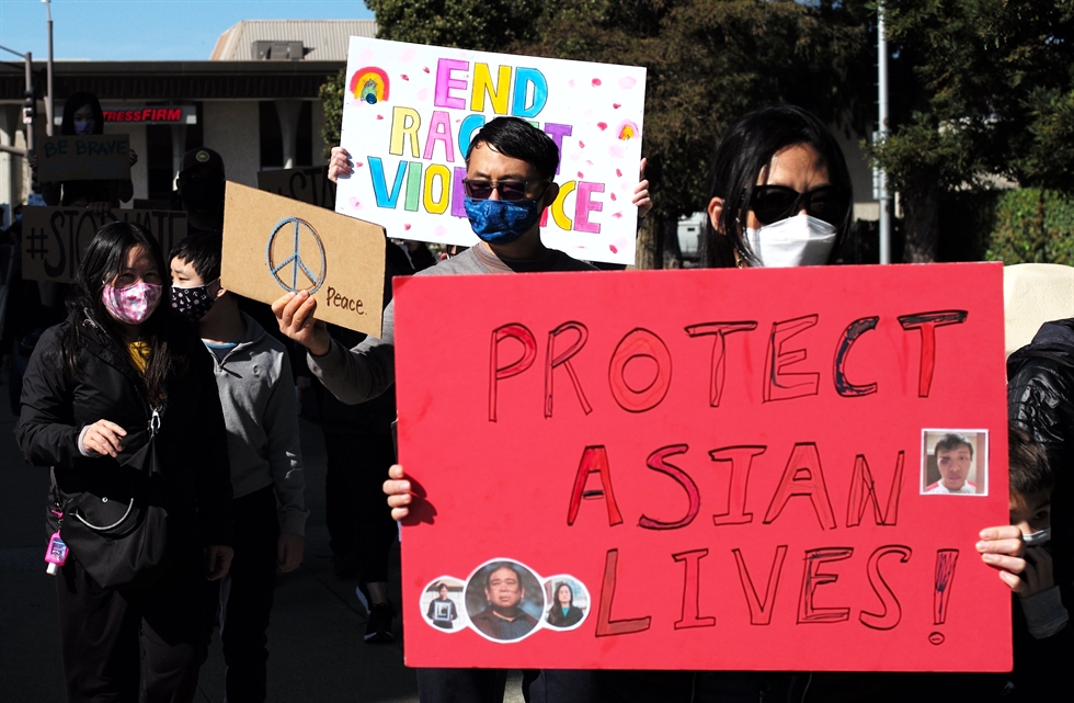 People take part in a protest against anti-Asian hate crimes in San Mateo, Calif., Feb. 27. Xinhua-Yonhap