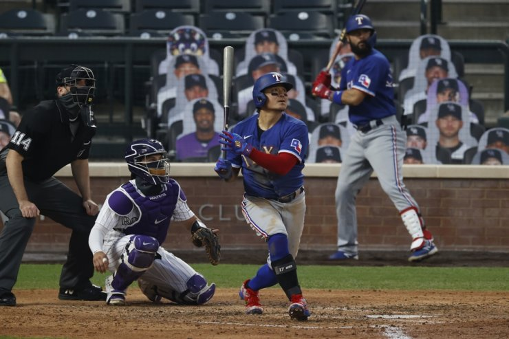 This Aug. 15, 2020, file photo shows Texas Rangers left fielder Choo Shin-soo at bat in the fifth inning of a baseball game against the Colorado Rockies in Denver. AP