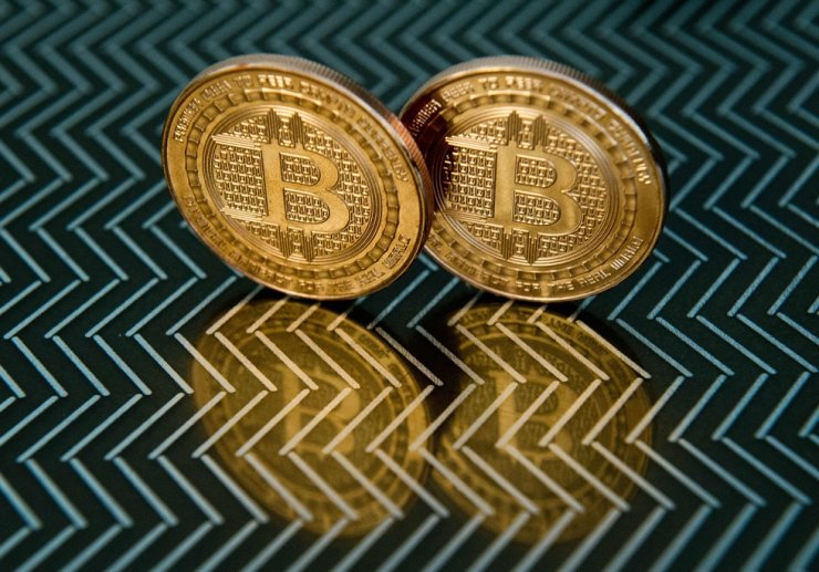 This file photo taken on June 17, 2014, in Washington, DC, shows bitcoin medals which use peer-to-peer technology to operate with no central authority or banks. Korea's financial authorities are moving to impose an income tax on cryptocurrency trading from next year. AFP