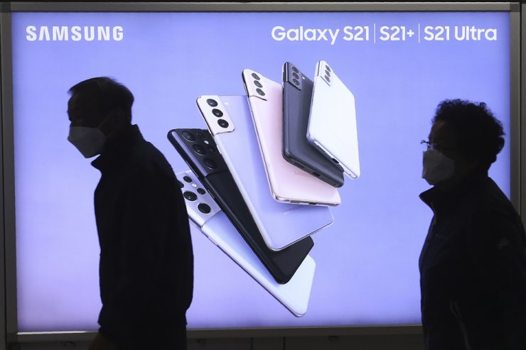 People pass by an advertisement of Samsung Electronics' Galaxy S21 Series smartphones at a subway station in Seoul, South Korea Wednesday, April 28, 2021. AP