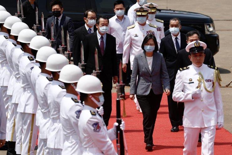 Taiwanese President Tsai Ing-wen, center, reviews the honor guard upon arrival during the official launching of Taiwan's new amphibious transport dock YU SHAN (LPD-1401) in Kaohsiung, Taiwan, April 13. EPA