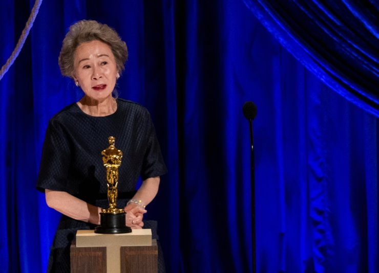 Actress Youn Yuh-jung accepts the Oscar for the Best Actress in a Supporting Role for her role as 'Soonja' in the film 'Minari,' during the live ABC Telecast of the 93rd Academy Awards in Los Angeles, California, on Sunday, local time. Reuters-Yonhap