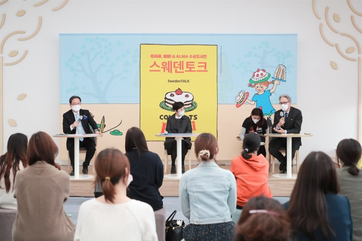 Namyangju Mayor Cho Kwang-han, left, picture book artist Baek Hee-na, second from left, and Swedish ambassador to Korea Jakob Hallgren, right, participate in the SwedenTalk program during the opening ceremony of the 'Congrats, Pippi! & Astrid Lindgren Memorial Award (ALMA)' exhibition at the Jeong Yak-yong Library in Namyangju, Gyeonggi Province, March 26. Courtesy of Namyangju City