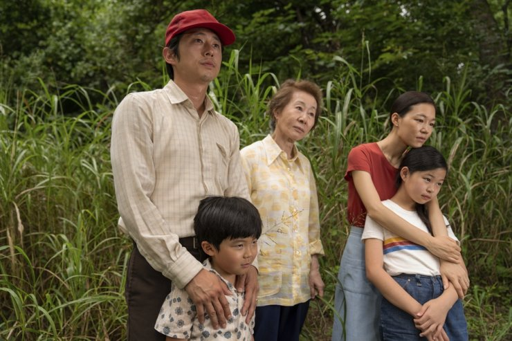 This image released by A24 shows, from left, Steven Yeun, Alan S. Kim, Youn Yuh-jung, Han Ye-ri, and Noel Cho in a scene from 'Minari.' AP