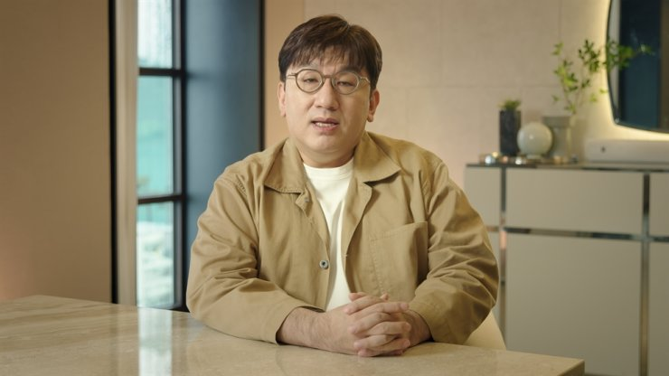 Hybe founder and CEO Bang Si-hyuk speaks in an online message to announce his plan for debuting a new 'global boy band' in collaboration with Universal Music Group at his office in Seoul, Feb. 18. Courtesy of Hybe