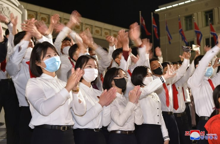In this photo released by North Korea's Korea Central News Agency on April 16, 2021, youths celebrate fireworks commemorating the birthday of the country's late founder Kim Il-sung, which was the previous day, at Pyongyang. Korea Times file