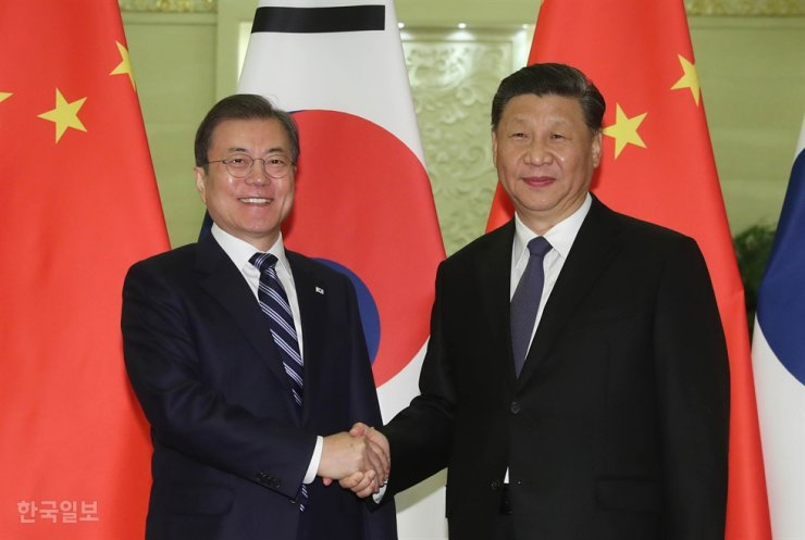 President Moon Jae-in shakes hands with his Chinese counterpart Xi Jinping in Beijing, China, Dec. 23, 2019. Korea Times file