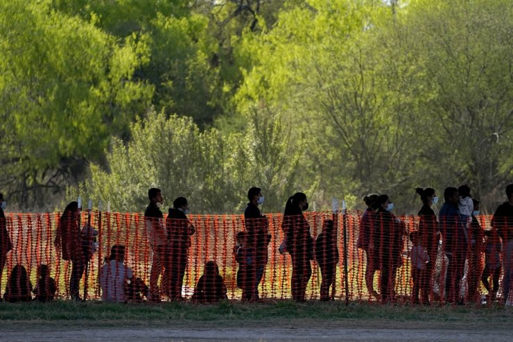 Migrants are seen in custody at a U.S. Customs and Border Protection processing area under the Anzalduas International Bridge, in Mission, Texas, in this March 19 file photo. AP