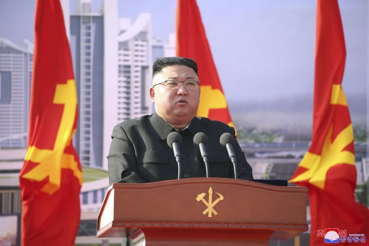 In this photo provided by the North Korean government, North Korean leader Kim Jong-un speaks during a ceremony to break ground for building 10,000 homes, in Pyongyang, North Korea, Tuesday, March 23, 2021. AP