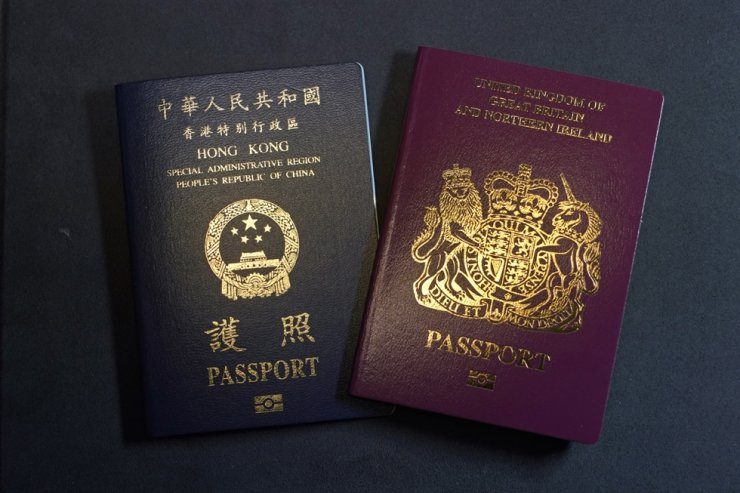 In this Friday, Jan. 29, 2021 file photo, a British National Overseas passports (BNO) and a Hong Kong Special Administrative Region of the People's Republic of China passport are pictured in Hong Kong. AP