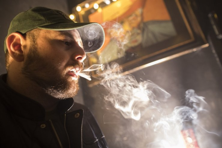 In this March 29, 2019, file photo, a man smokes marijuana at a Spleef NYC canna-cocktail party in New York. New Yorkers can now possess and use up to 3 ounces of cannabis under a legalization bill signed Wednesday, March 31, 2021, by Gov. Andrew Cuomo. AP