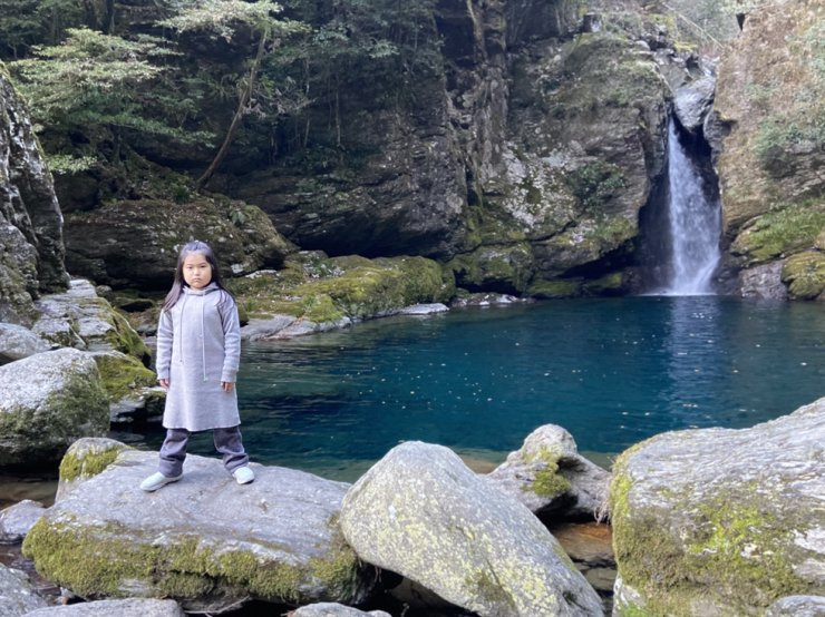 Almost-nine-year-old musician RAAI at Nikoubuchi waterfall in Japan's Shikoku / Courtesy of TENGGER