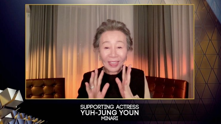 Youn Yuh-jung receives Supporting Actress BAFTA award for 'Minari' during the 74th British Academy Film Awards in London, April 11. Handout via Reuters