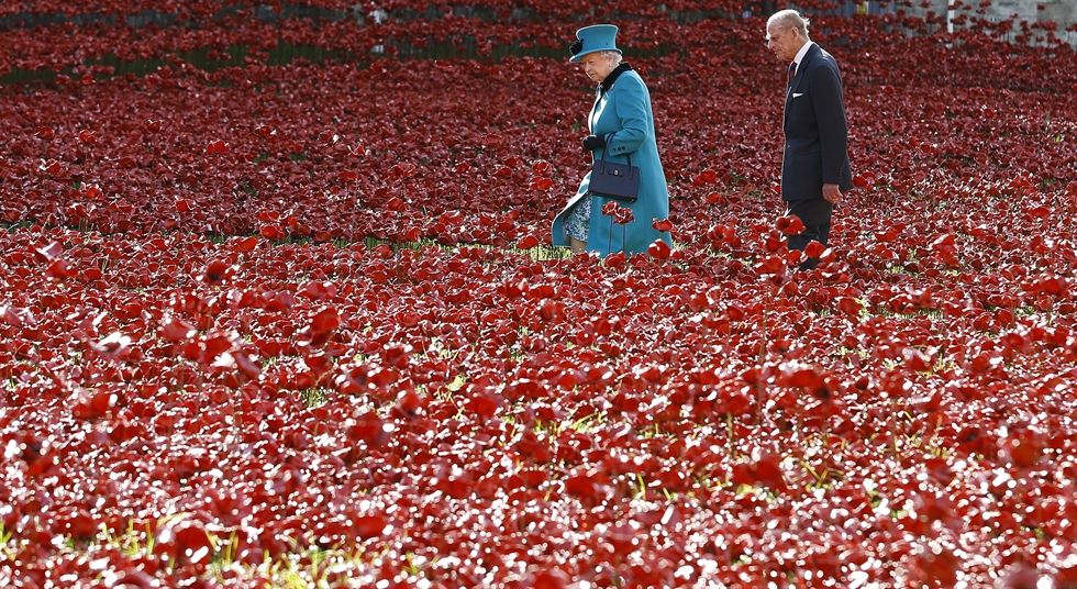 A man pauses after leaving a flower tribute outside the gates of Buckingham Palace in London, April 9. Buckingham Palace officials say Prince Philip, the husband of Queen Elizabeth II, has died. He was 99. AP