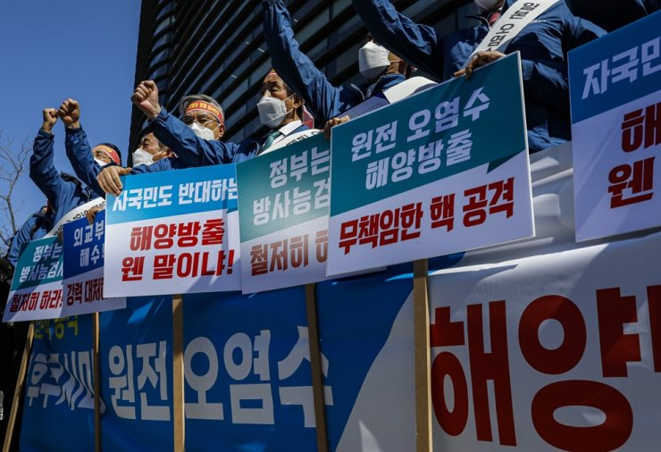 Protestors from the Korean fisheries industry take part in a rally in front of the Japanese Embassy in Seoul, Wednesday, to criticize Tokyo's decision to discharge radioactive water from the Fukushima nuclear plant into the Pacific Ocean. Korea Times photo by Shim Hyun-chul