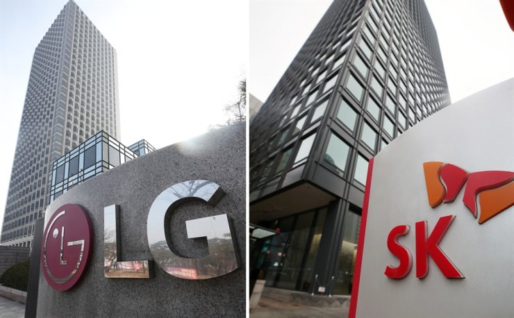 Headquarters of LG in Yeouido, Seoul's Youngdeungpo District, and SK in Seoul's Jung District are seen. Yonhap