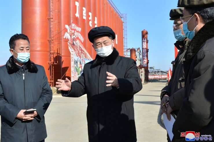 North Korea's Vice Premier Kim Deok-hun, second from left, according to Korean Central News Agency on Mar. 4, visits a construction site for a new carbon-related chemical factory. Yonhap