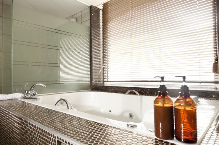 Local hotels are moving to change single-use bathroom amenities to multi-use pump bottles in preparation for the government's ban on use of disposable products next year. gettyimagesbank