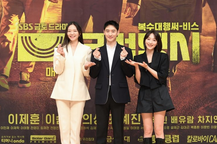 Actors Esom, from left, Lee Jae-hun, and Pyo Ye-jin pose for pictures during an online press conference for 'Taxi Driver,' Tuesday. Courtesy of SBS