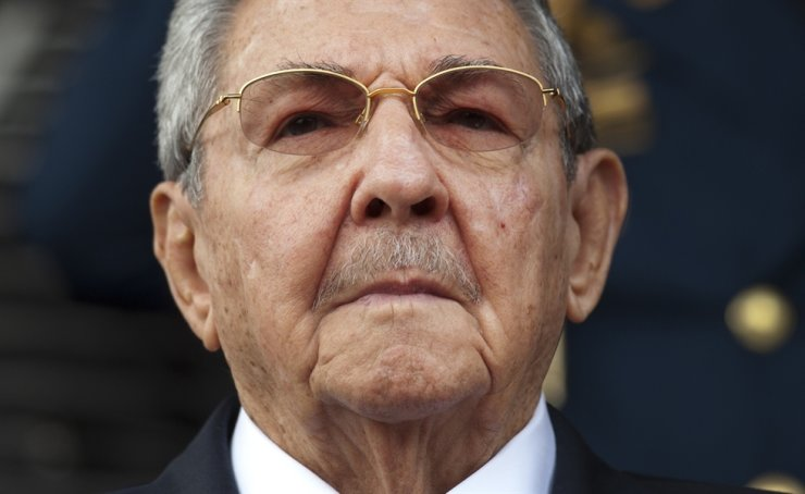 Cuba's President Raul Castro listens to the Cuban and Venezuelan national anthems during a welcome ceremony at the Miraflores presidential palace in Caracas, Venezuela, in this March 17, 2015 file photo. On Friday, Castro formally announced he'd step down as head of the Communist Party, leaving Cuba without a Castro in an official position of command for the first time in more than six decades. AP-Yonhap