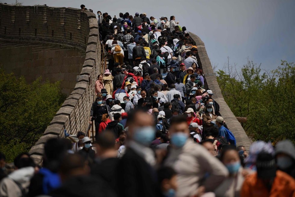 Travelers wait at a train station in Nanchang in central China's Jiangxi Province, April 30. AP-Yonhap