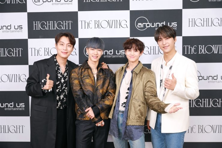 Members of K-pop boy group Highlight pose for photos during an online media conference, Monday. Courtesy of Around US Entertainment