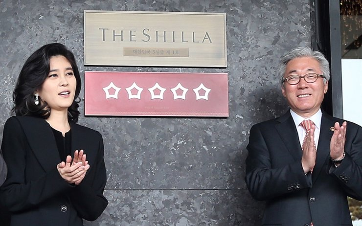 Hotel Shilla CEO Lee Boo-jin, left, poses by the hotel entrance in central Seoul, in this photo taken in May 2015. Korea Times file