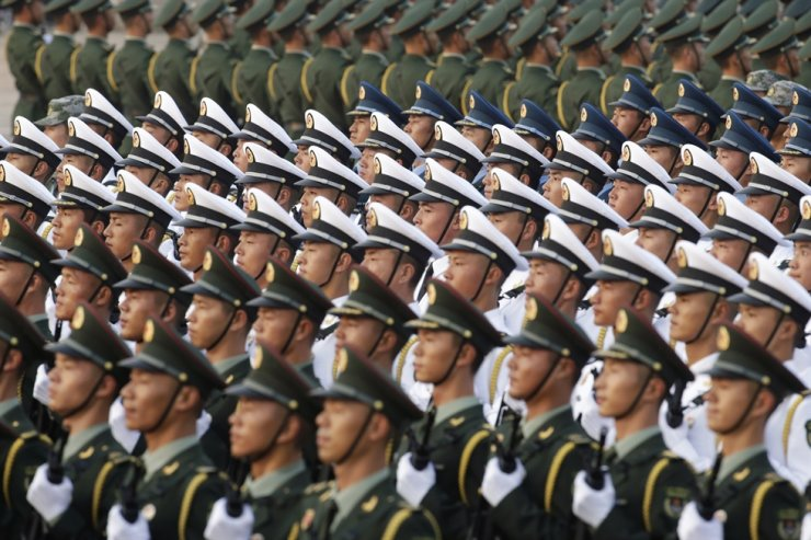 In this Oct. 1, 2019, file photo, soldiers of People's Liberation Army stand in formation near Tiananmen Square before a military parade marking the 70th founding anniversary of People's Republic of China in Beijing. China's newly commissioned nuclear-powered submarine is now armed with the country's most powerful submarine-launched ballistic missile capable of hitting the U.S. mainland, a source said. Reuters-Yonhap
