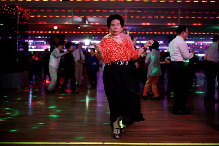 Elderly people dance at the New Hyundai Core colatec in Seoul, South Korea, April 10, 2018. Reuters/Kim Hong-Ji