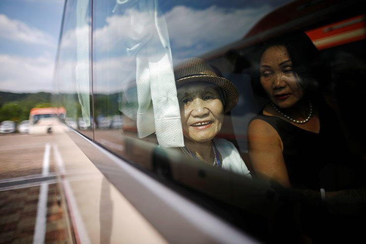 A South Korean participant for a reunion sits inside a bus as she arrives at the South's CIQ (Customs, Immigration and Quarantine), just south of the DMZ in Goseong, South Korea, August 20, 2018. Reuters