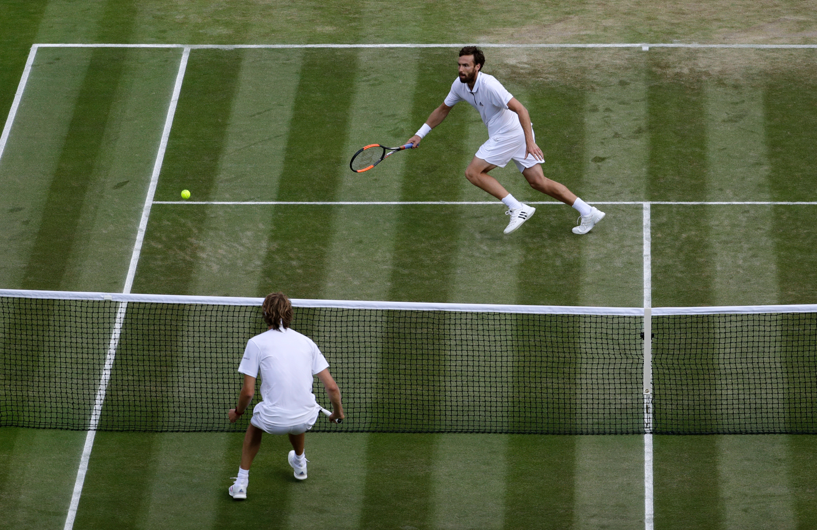save off 2b4e2 fb3c2 Ernests Gulbis of Latvia, top, returns the ball to Alexander Zverev of  Germany during their men s singles match on the sixth day at the Wimbledon  Tennis ...